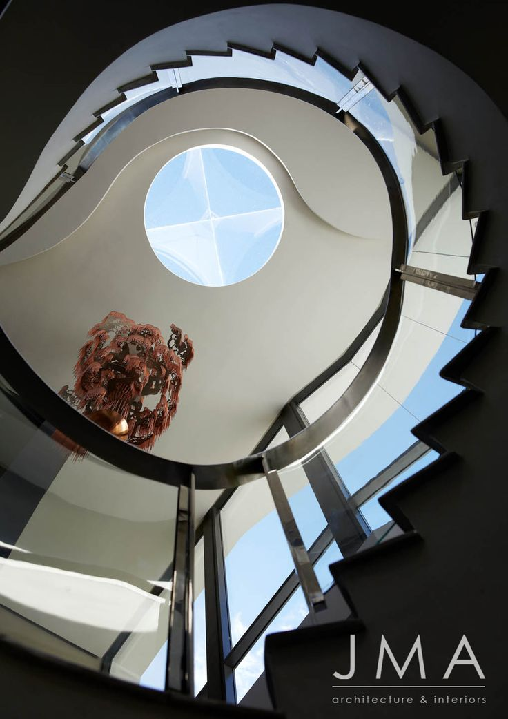 Abstract photography with staircase skylight.