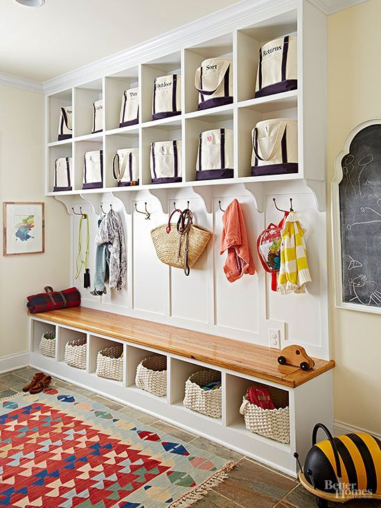 Built-ins keep even a bustling mudroom organized. Within these convenient…