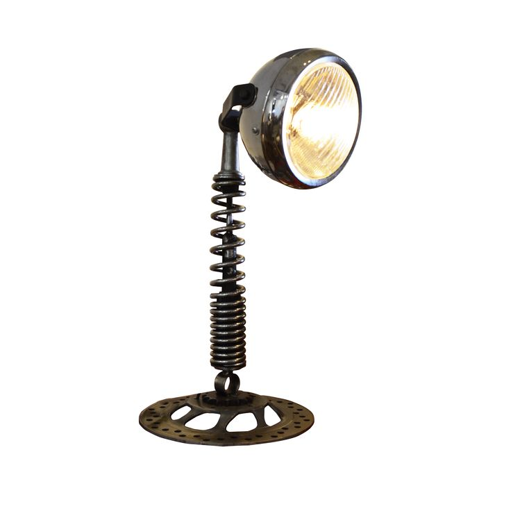Spring Table Lamp. Creatively retrofitted with headlights, these vintage components are transformed into unique lamps, waiting to unleash their functional potential again.