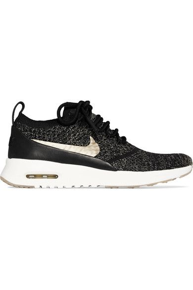Nike's Air Sole debuted in the late '70s and remains one of the brand's most popular features. Fitted with the cushioning unit, these 'Air Max Thea Ultra' sneakers are made from black Flyknit that's flecked with metallic gold threads and finished with a coordinating Swoosh. Wear them with everything from skirts to denim.