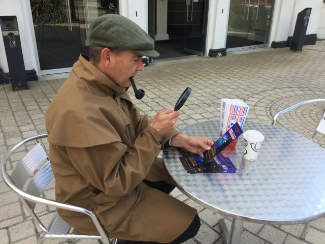 A curious looking fellow enjoying coffee and popcorn (interesting combo) outside the Halls. Don't miss The Mousetrap from 28 Sept - 3 Oct 2015.  http://www.dorkinghalls.co.uk/article/10756/Live-Shows