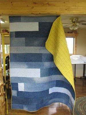 Six and 8 inch strips from denim pants...bright yellow backing....wildly interpretive sunflowers quilting done with bright yellow top thread and denium blue bobbin thread...beautiful