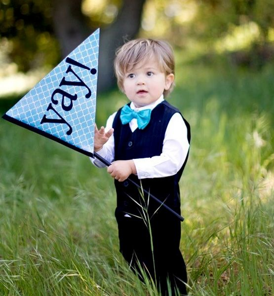 """""""They're a fun alternative to pillows for the ring bearers, especially because most ring bearers aren't trusted with the actual rings. Guests always love when the little boys are walking down the aisle waving such a happy flag."""""""
