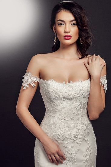 'Pamela' uses our Adele Lace. Adele is a sophisticated ivory corded lace. #cordedlace #lace #lacefabric #ivorylace #weddingdress #weddinglace #lacefabric