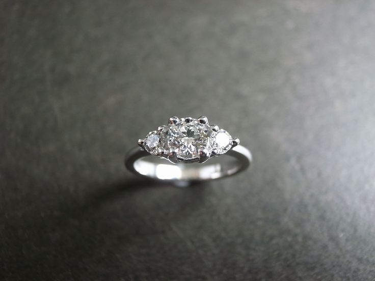 3 stone engagement ring but with diamonds around the band part.: