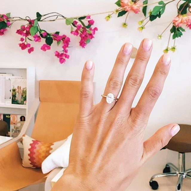 One of our favs @jagjaguar swung w her first ENGAGED manicure. We can't stop staring at that ring! (I'm biased too - Love gold + oval! ) #oliveyou @howyouglow Xx @gibsontuttle