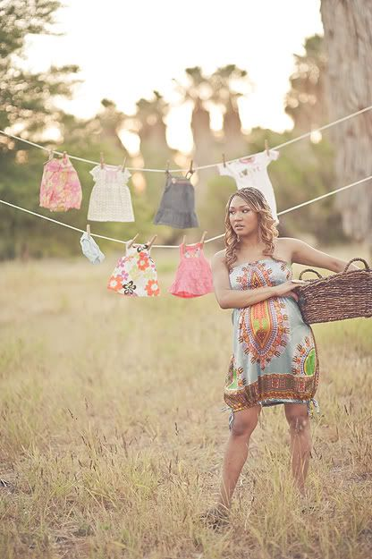 Maternity Photo Shoot: I love the baby clothes in the background! This might be really cute to do with a newborn shoot, too! It's a sentimental way to remember some of the cute gift outfits baby received:-)
