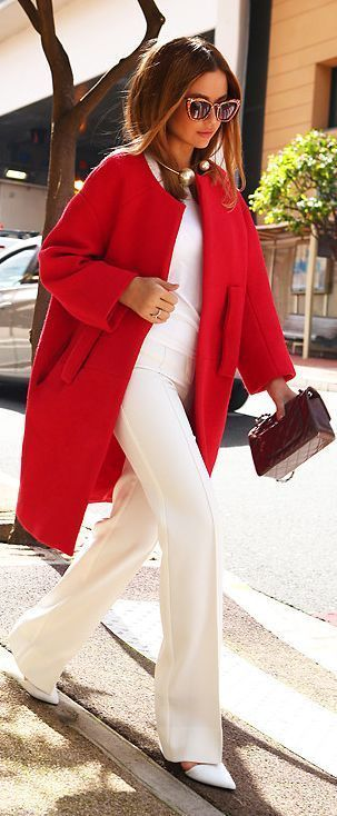 Chic white outfit with collarless red coat