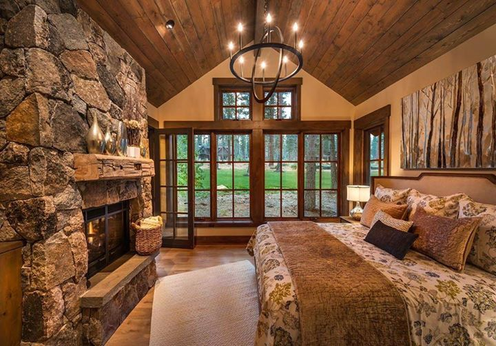 What about this little rustic bedroom??? I'm dreaming over that fireplace!