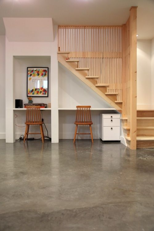 Basement ideas via design mom: polished concrete, under stair desk, beautiful stairs