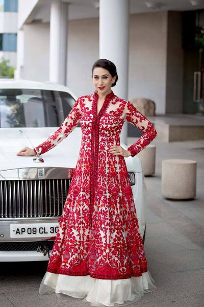 Cocktail Outfit - Karishma Kapoor in a Red Threadwork Jacket with a White Net Lehenga | WedMeGood #wedmegood #cocktailoutfit #threadwork #indianbride #indianwedding #red