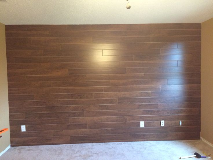 Wood Plank Wall Using Inexpensive Laminate Flooring Put Up With A Nail Gun Nails Are