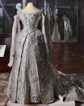 Ceremonial dress at court of Grand Duchess Alexandra Russia, St. Petersburg. 1894 Workshop O. Bulbenkovoy Visit the sections: ∙ ∙ The court suits Empress Alexandra Feodorovna, wife of Nicholas II Silver brocade, silver thread, silk, beat, glitter, wire, feathers, lace; embroidered bodice: back length 33.0; Skirt length 169.0; trail length 340.0 On the ribbon corsage stamp printed in gold workshop: Ms. OLGA DRESS St. Peterburg Wash Post number 8. in 1941 of the GME Inv. Number EFV-13158-c
