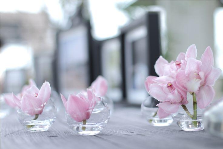 Registration table with mauve Cymbidium in glass by Tirtha Bridal Uluwatu Bali