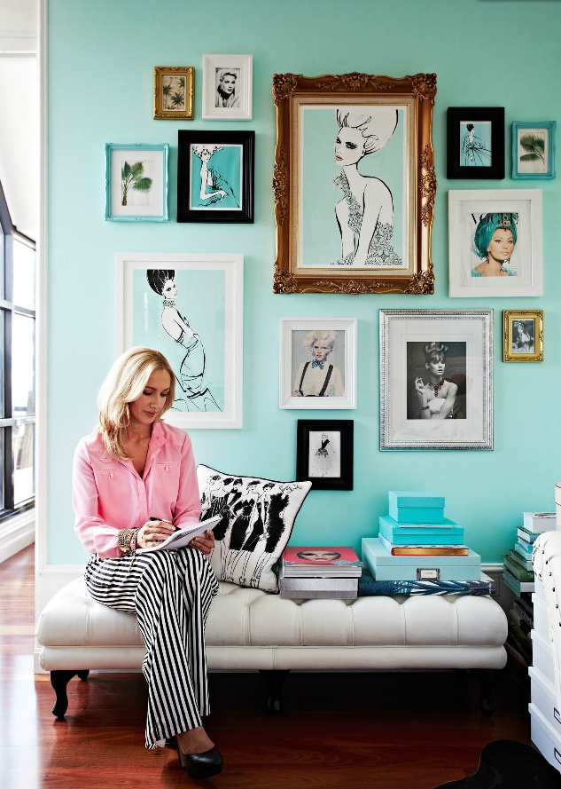 Mix of frames on turquoise wall.