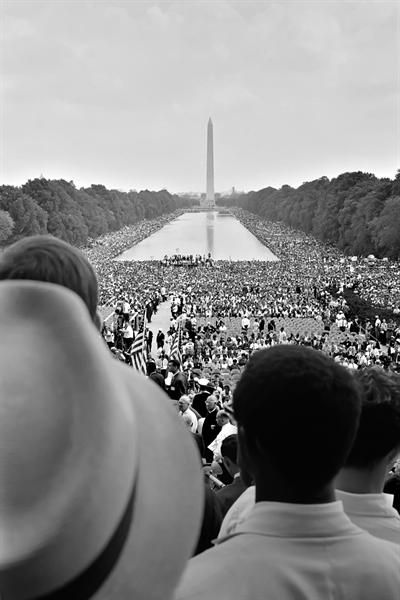 """On August 28, 1963, 200,000 people participate in a peaceful civil rights rally in Washington, D.C., where Dr. Martin Luther King Jr. delivers his """"I Have a Dream"""" speech in front of the Lincoln Memorial."""