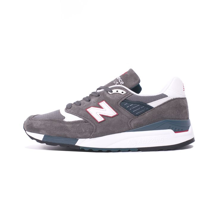 Essential reworking of the much loved New Balance 998 runner.  The made in USA M998CRA features a premium suede & mesh upper, stunning grey & red color combo.
