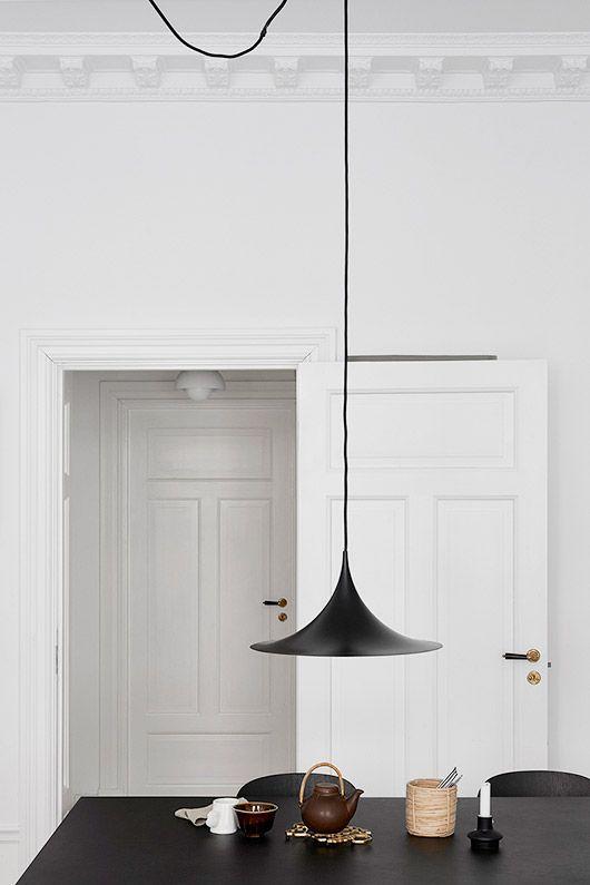 blank hanging lamp over black dining table via fantastic frank. / sfgirlbybay