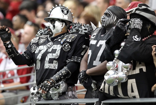 passionate fan base.. #Raider Nation - The Black Hole. If I ever go to a game I wanna do this:)