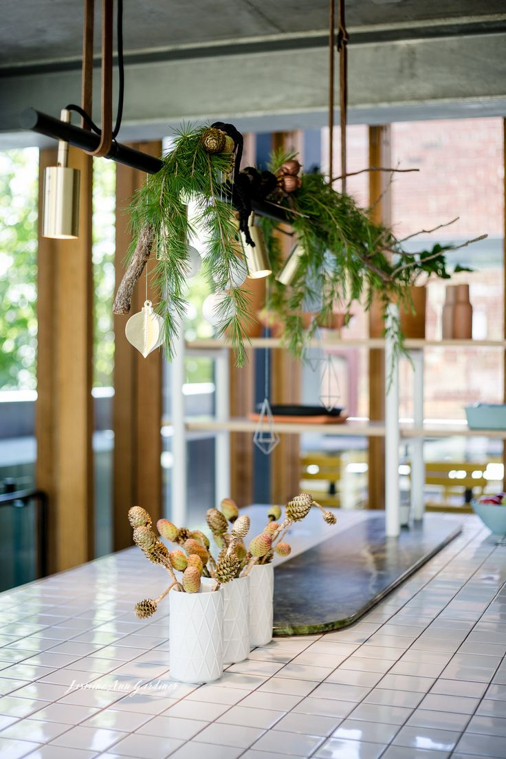 DY.o events (aka Duo) Soft and subtle Christmas hanging installation with gold sprayed leucadendron nuts