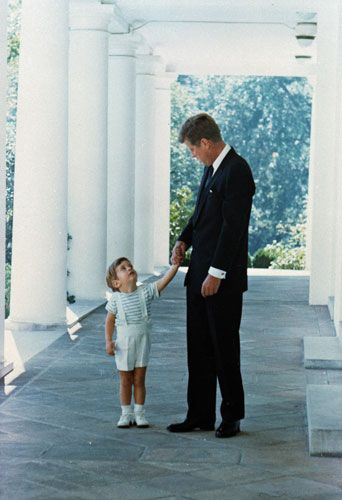 President John F. Kennedy with JFK Jr at the White House                                                                                                                                                                                 More