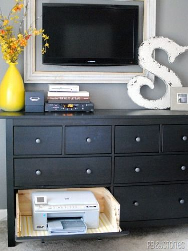 a fold-down printer compartment in a dresser by simply removing the front panel of the drawer and adding hinges. How to Hide Household Eyesores - Smart Home Decorating Ideas - Good Housekeeping