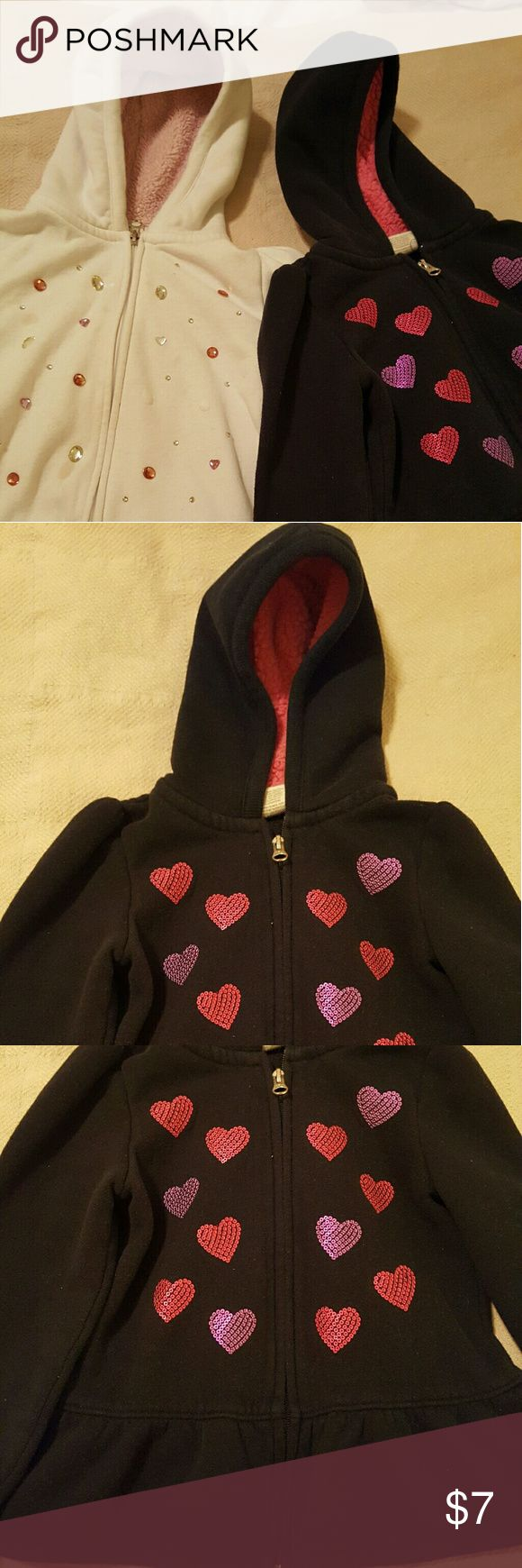 Children's size 5 and 6 zip up hoodies Children's size 5 and 6 zip up hoodies, Sonoma black and white sweater/jackets, black has hot pink and purple sequin hearts, white one has pink and diamond oval and heart rhinestones. As seen in pictures the white hoodies has some stains that I could not get out without having to use something that may have harmed the material. Sonoma Shirts & Tops Sweatshirts & Hoodies