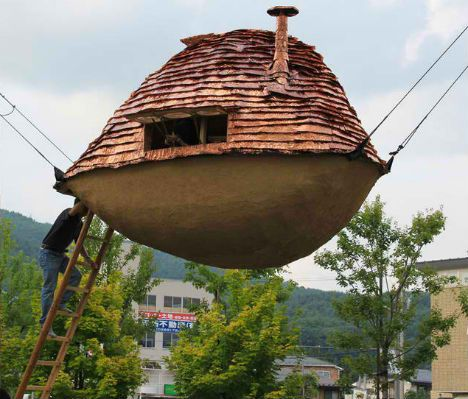 Could this beautiful hanging tea house suspended structures absorb shock well in the event of an earthquake and would be well out of the way of possible tsunamis.