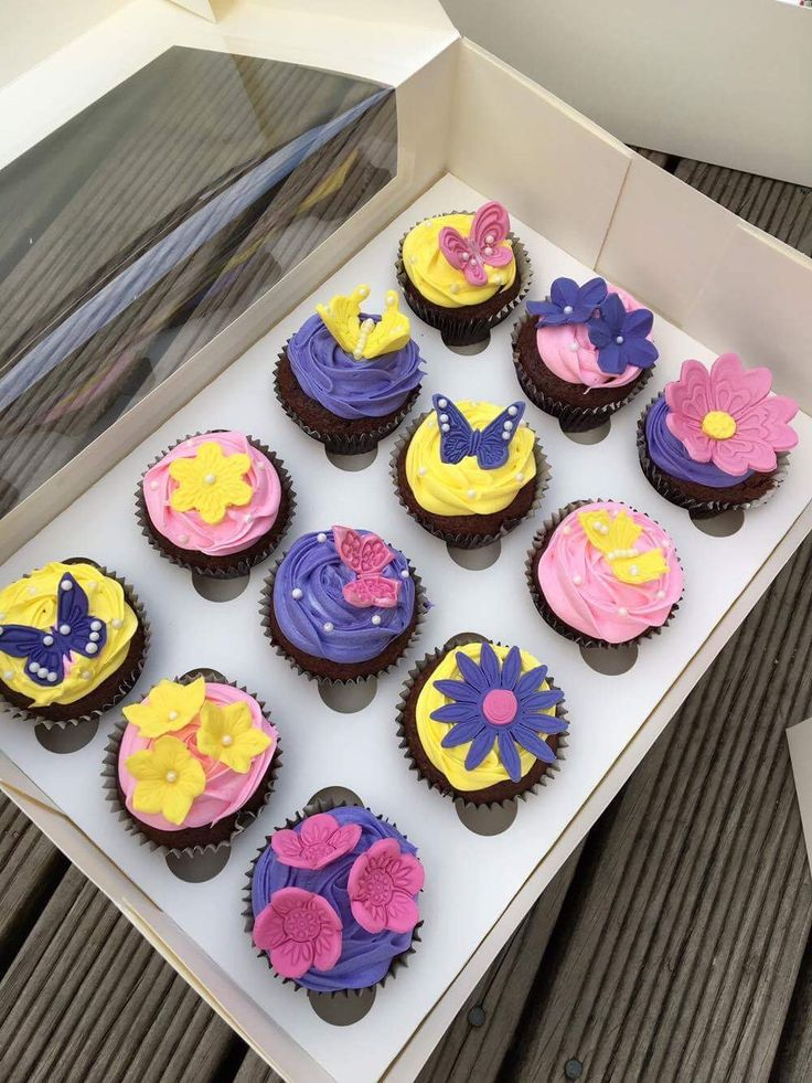 Pretty Butterfly & Flower cupcakes! Perfect for a girls birthday party. Bright colours, pink purple and yellow.  Check out my page https://www.facebook.com/frosted.cupcakes.invercargill/