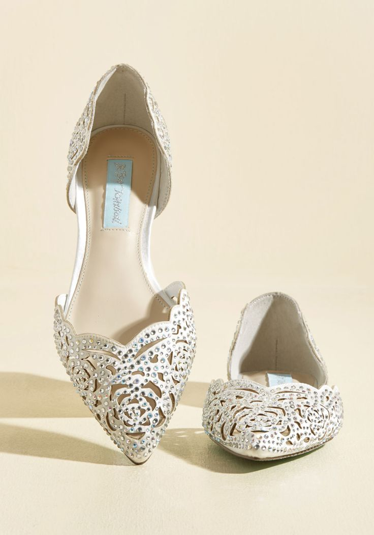 Sashaying to your seat in these opulent flats from Blue by Betsey Johnson, your luxe look gives this fine dining experience extra stars. Glistening with sparking rhinestones atop pure white satin, this posh pair continues to wow with pointed toes, scalloped edges, and rose-shaped cutouts!