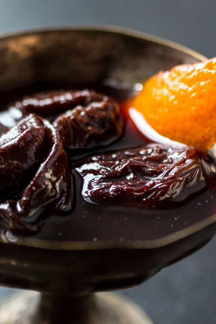 I know what you're thinking: stewed prunes But this is not that This is prunes poached in wine, a classic French dessert that you still see on dessert trolleys in bistros all over Paris