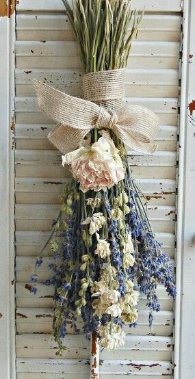 Dried garden flowers, with a burlap bow, simple perfection.