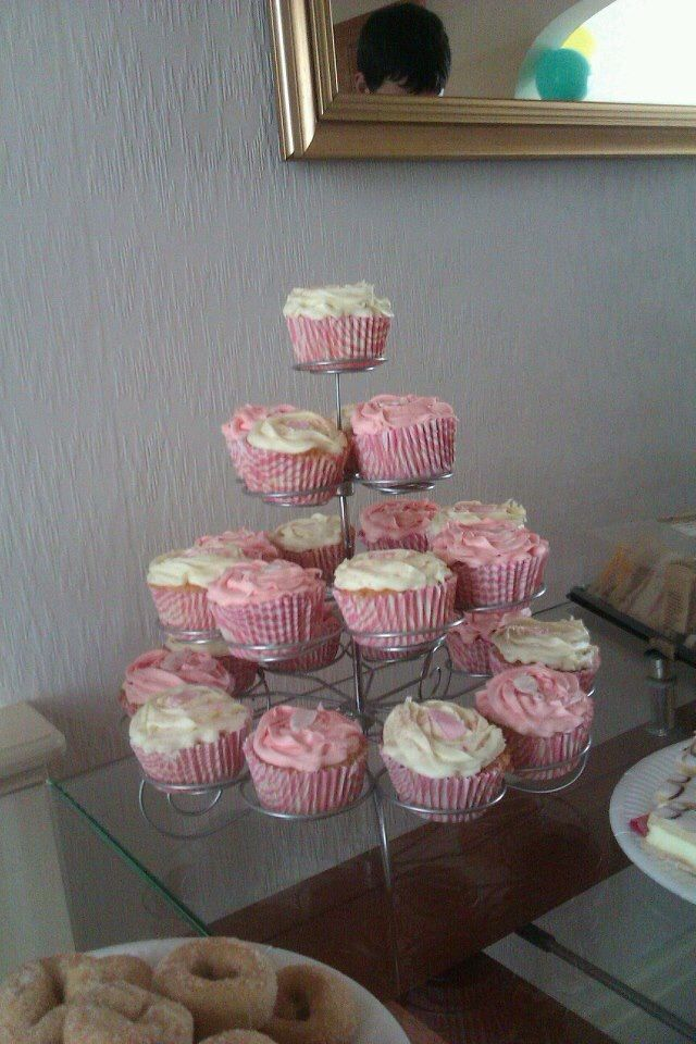 Vanilla cupcakes for a baby shower- they have icing bottles, rattles, and dummies on.