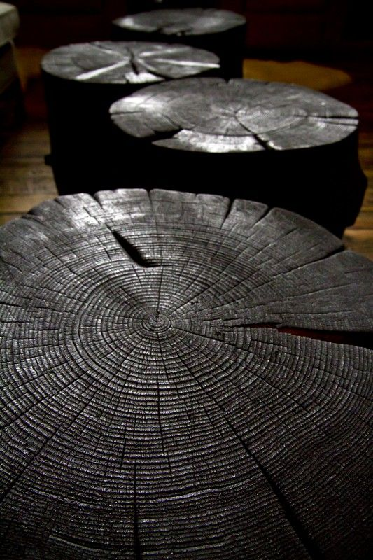 Wood stool in front of fireplace. house interiors shou sugi ban - Google Search