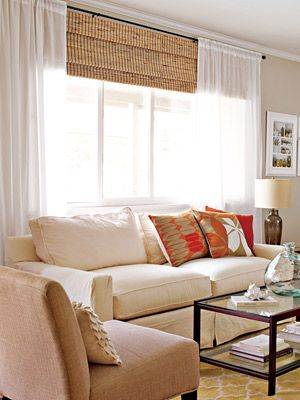 Clean, bright living room. Tip: hang curtains close to the ceiling and covering just the frame to create extra height and wide windows.