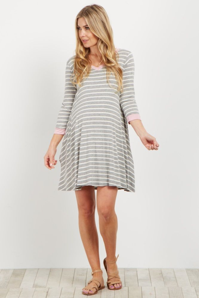 This basic striped maternity dress just took it up another notch. A colorblock trim and stripes pair with each other to create a chic casual combo. Style this dress with sneakers and a denim jacket for a complete look.