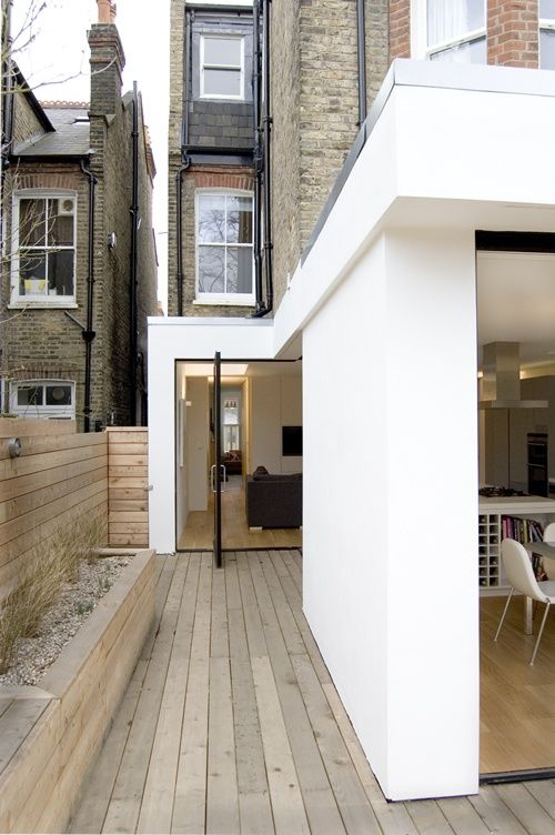 Modern Extension On A Victorian Brick House