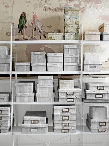 Cover cardboard boxes in old French maps and newspapers to create an artsy storage space. #decoratingideas