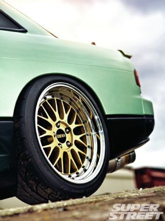 Michael is not a stranger to the import scene, he's built a few cars in his day. So after sourcing a completely stock '91 240SX coupe, his minty fresh S13 began to slowly take shape. Click to check out Michael Heasley's 1991 Nissan 240SX. - Super Street Magazine