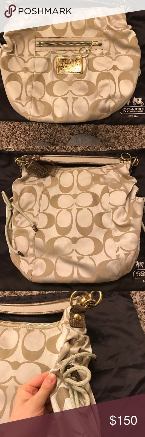 "Cream signature Coach hobo bag Cream signature Coach hobo bag. Has ties on each side. Gold embellishments. Fun clear ""Coach"" luggage tag. Strap is sparkly copperish color. Coach Bags Hobos"
