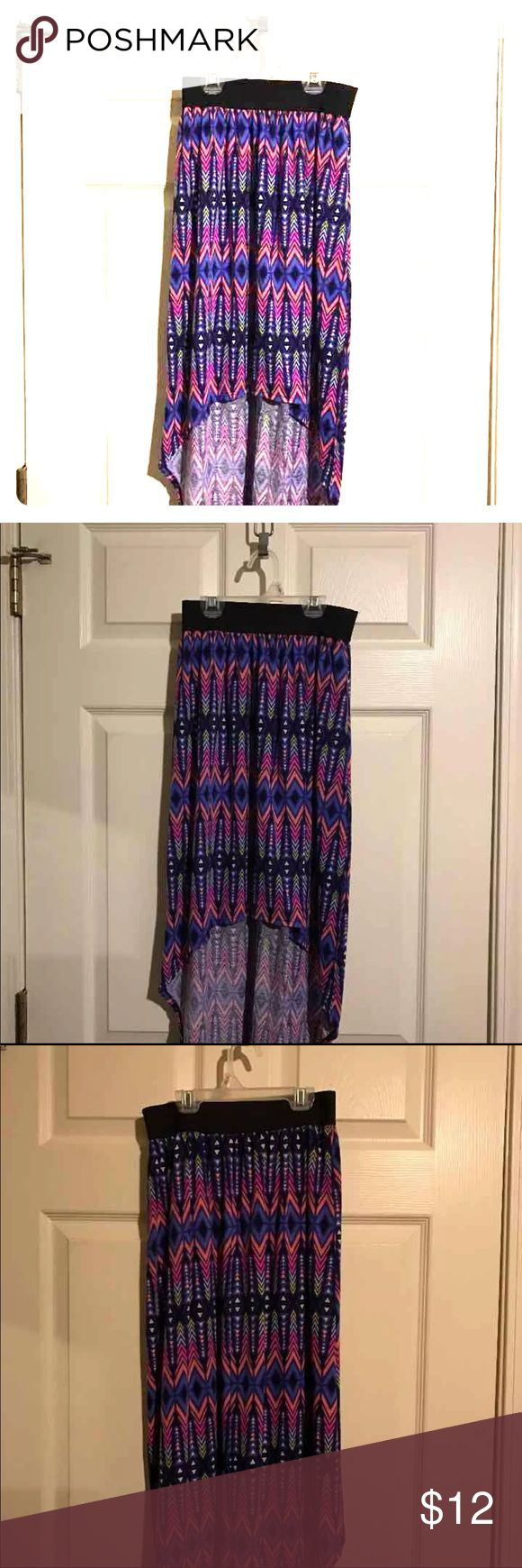 Cute Hi-Lo Tribal Skirt Very comfy hi-low skirt. Elastic waistband makes it flattering for almost all sizes, S, M or L. Aztec print in purple, pink and black. Great dress for any occasion! Skirts
