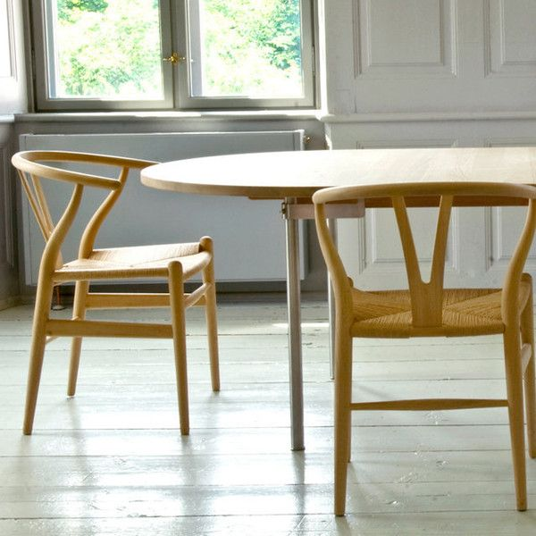 """Wegner Wishbone Chair   Hans J. Wegner (1949)  The Wegner Wishbone Chair or """"Y-chair"""" as it is sometimes called due to the shape of its back, was designed in 1949 and was the first of Wegner's chairs for Carl Hansen & Son. Light in weight and relatively compact, the Wishbone Chair is ideal for conversations around the dining table. The curved back legs give it an air of grace while the stylish semicircular top rail offers support to the back and adds to the elegance of the chair. $500.+"""