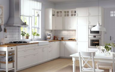 IKEA- Traditional kitchen with white cabinets, wood worktops, glass doors and integrated appliances