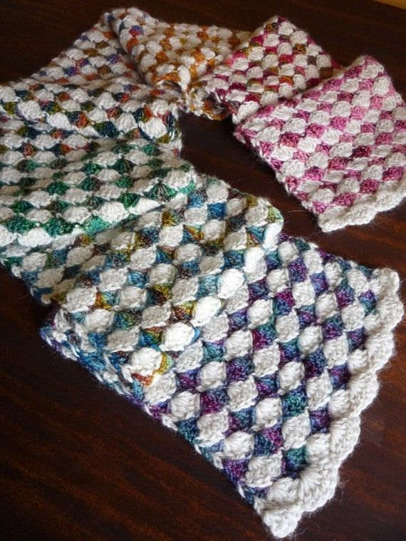 Color Inspiration :: Pretty diamond-pattern scarf done in shell stitch, alternating rows of variegated yarn with white. (Easy shell stitch pattern free by Amy Ramnarine of The Stitchin' Mommy: http://thestitchinmommy.com/2013/12/shell-stitch-baby-blanket-free-pattern.html ) . . .   ღTrish W ~ http://www.pinterest.com/trishw/ . . .    #crochet