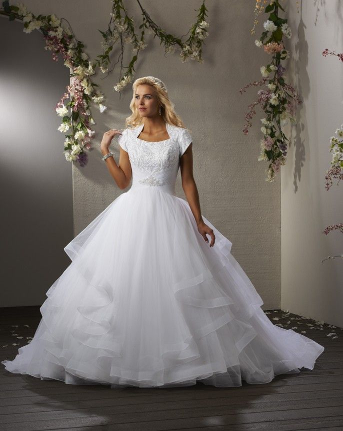 This modern sleek gown has a modest bodice covered with for Modest ball gown wedding dresses