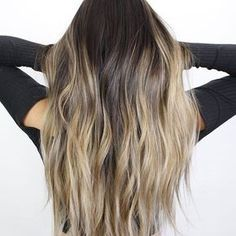 blonde balayage on dark hair. ashy blonde highlights. dimensional blonde hair. long bronde hair