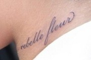 "Rihanna's neck tattoo - French ""Rebelle fleur"" meaning Rebellious flower"