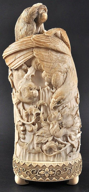 A FINE 19TH CENTURY JAPANESE MEIJI PERIOD IVORY TUSK VASE AND COVER with recumbent ape finial, the body extensively carved with eagles and monkeys amongst boldly carved foliage. Signed. 11.75ins high.