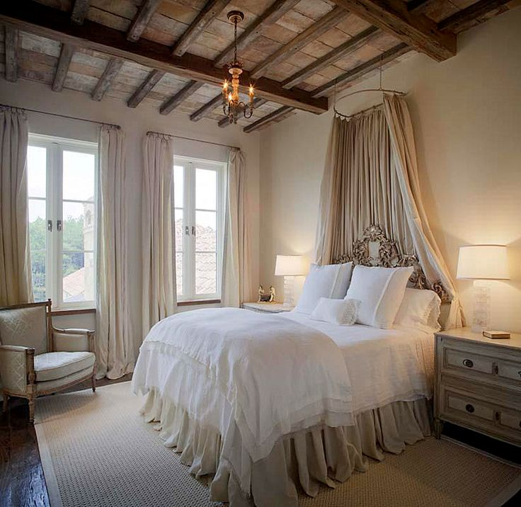 Dreamy Bedroom - windows and beams and gorgeous linens.... the neutral color scheme and gorgeous bedding give this room an air of elegance.....