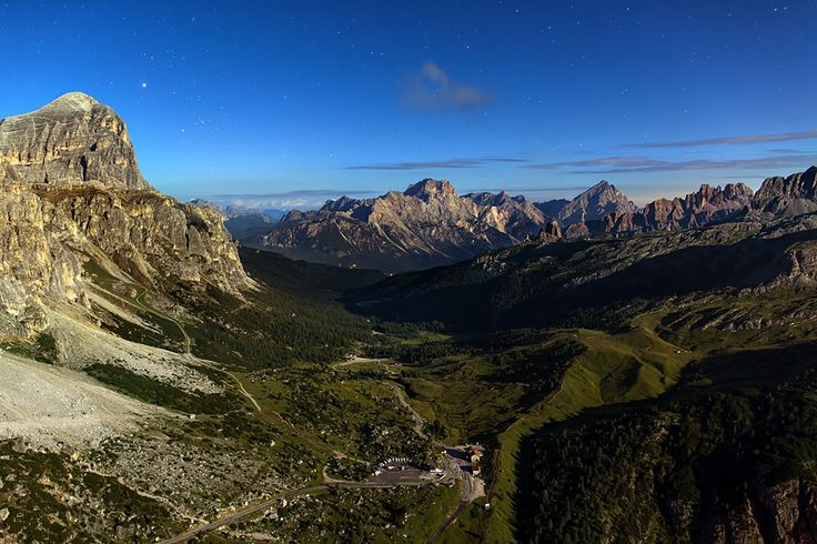 The full moon in the starry sky, lighting up the night like day. From the top of the mountain was great to admire the landscape below me. The Falzarego, the tranquility of the night, and all around green fields, Dolomites and stars.